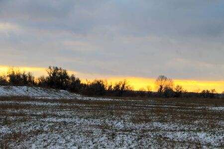 Sunset on the winter meadow Stock Photo