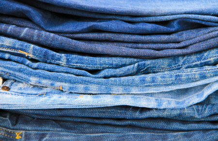 slacks: Stack of the blue jeans close-up Stock Photo