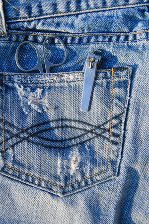clippers: Nail scissors and clippers in the blue jeans pocket Stock Photo
