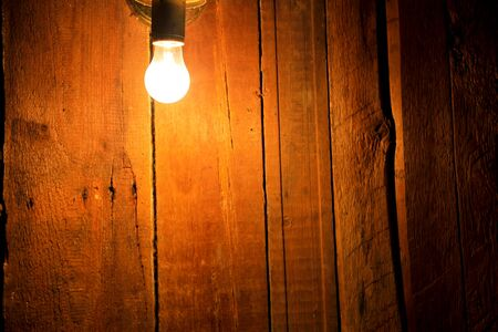 electric bulb: Electric light bulb on the wooden background