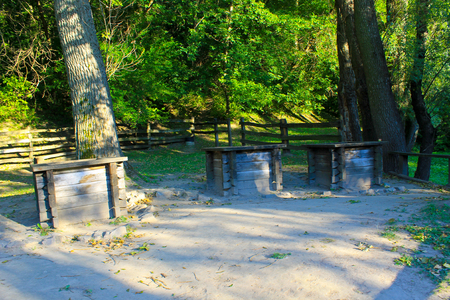 Three antique wooden wells in the forest, Ukraine