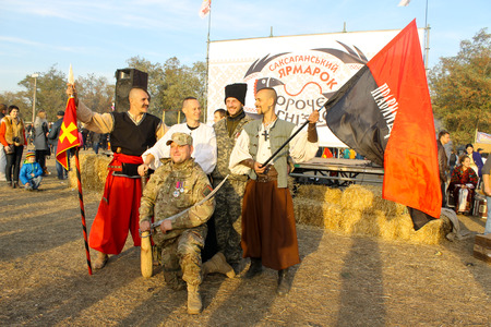 Saksagan, Ukraine - October 17, 2015: Ukrainian Cossacks and fighter of right sector pose for photo during fair Soroche hnizdo (Magpie nest) dedicated to the harvest Editorial