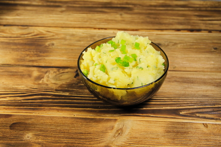 carbohydrates: Mashed potatoes in glass bowl on wooden table