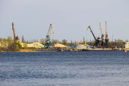 Harbor cranes at cargo port on the river Dnieper in Kremenchug, Ukraine Zdjęcie Seryjne