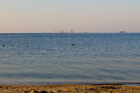 Seascape with fishing nets on horison Stock Photo