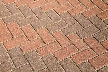 Sidewalk textured background. Detail of a pavement