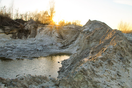 sandy soil: Sand pit with water in quarry