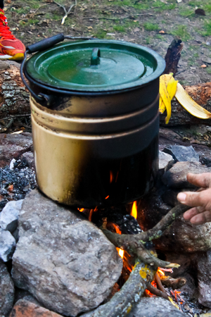 outdoor fireplace: Cooking on a campfire