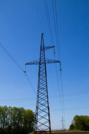 metal grid: High voltage power line against blue sky