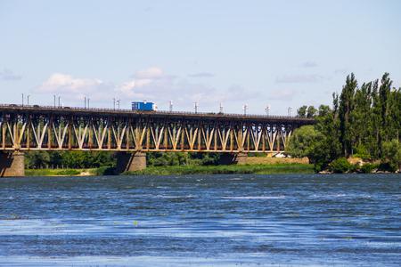 Bridge with traffic over the Dnieper river in Kremenchug, Ukraine