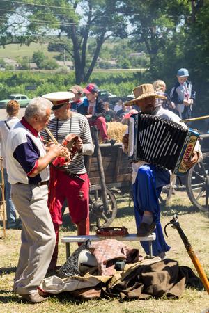 Kremenchug, Ukraine - June 3, 2017: Street folk musicians on performing during Strawberry festival Editorial