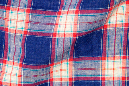 checker: Checkered fabric plaid  texture. Traditional Scottish pattern. Cloth background