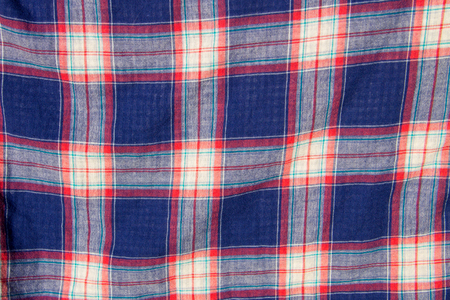 Checkered fabric plaid  texture. Traditional Scottish pattern. Cloth background