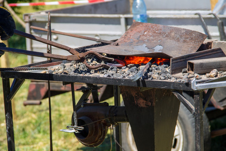 forge: Hot coals in a forge brazier Stock Photo