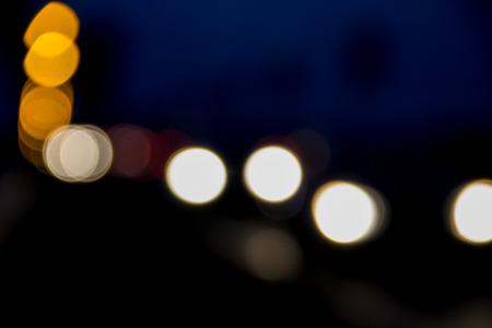 lamp light: Bokeh blurred car lights at the night Stock Photo