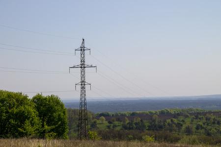 electric grid: High voltage power line against blue sky