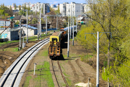 View on the maintenance train on railroad track Editorial