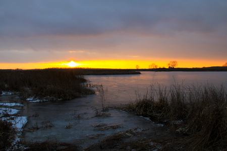 Sunset over the winter river Stock Photo