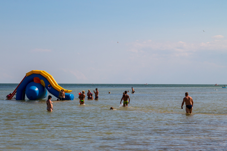 Genichesk, Ukraine - August 24, 2017: Inflatable water slide in Azov sea. Favorite vacation spot of children and adults Editorial