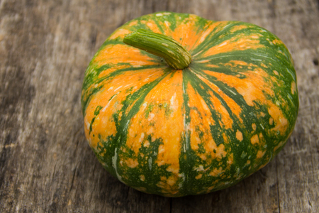 thanksgiving day symbol: Pumpkin on the rustic wooden table Archivio Fotografico