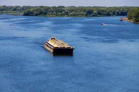 heavy industry: Barge floating on the Dnieper river in Ukraine
