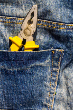 trouser: Pliers to repair in pocket of blue jeans