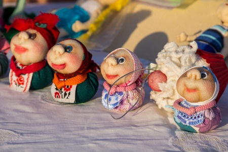 puppets: Dolls toys handmade souvenirs at the exhibition of folk arts Stock Photo