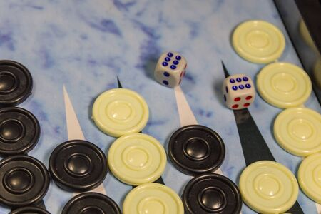 Game field in a backgammon with dice and checkers. Game concept. Board game
