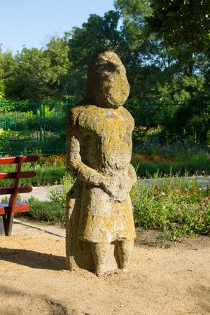 Ancient stone statue of a scythian warrior