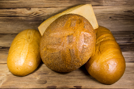 Assortment of baked bread on wooden table Stock Photo