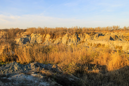 View on the granite quarry on autumn