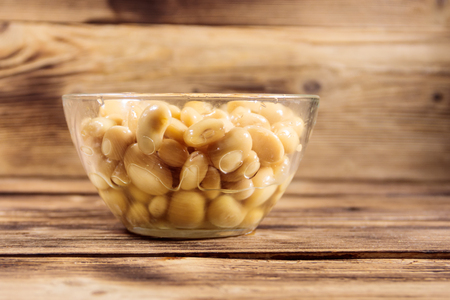 White kidney bean in glass bowl on wooden table Stock Photo