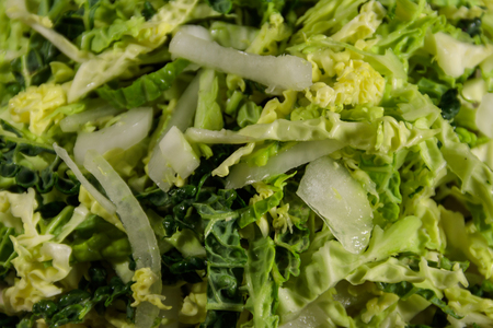 Fresh salad with savoy cabbage and onion close-up