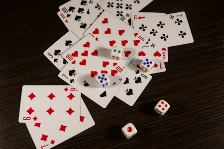 Playing cards and dice on a table. Game concept