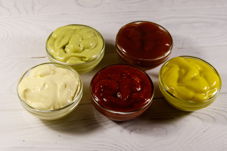 Set of sauces on white wooden table Banque d'images - 94580942