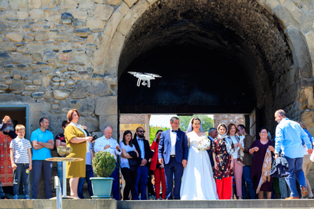 Mtskheta, Georgia - May 1, 2018: Bride and groom with their relatives and friends after ceremony in Svetitskhoveli orthodox Cathedral