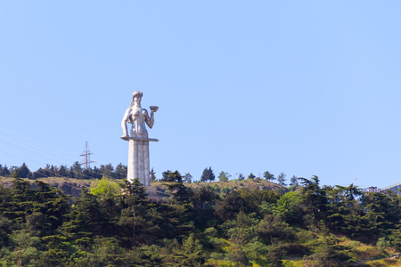 Monument of Mother Georgia in Tbilisi. Statue of a woman in traditional Georgian attire with a bowl of wine in one hand and a sword in the other, symbolizes the classic Georgian character