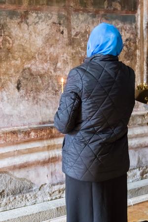 Woman prays in Svetitskhoveli Cathedral