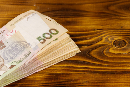 Ukrainian currency. Five hundred hryvnia banknotes on wooden desk Stock Photo