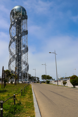 Batumi, Adjara, Georgia - May 3,2018:  Alphabetic Tower is a 130-meter-high structure in Batumi. The tower symbolizes the uniqueness of the Georgian alphabet and people