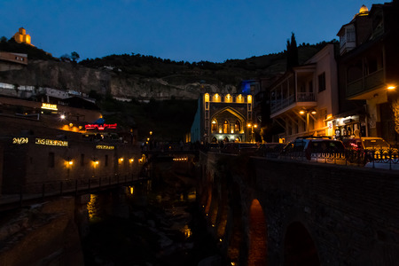 Night view of ancient district Abanotubani, known for its sulfur baths in Tbilisi, Georgia