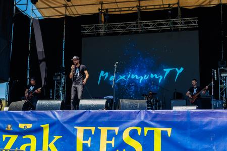 Dnipropetrovsk region, Ukraine - June 2, 2018: Rock band performs on a stage during outdoor free ethno-rock festival Kozak Fest Sajtókép