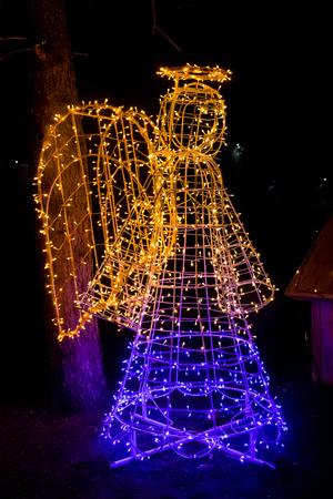 illuminated angel christmas decoration in city park stock photo 106884540