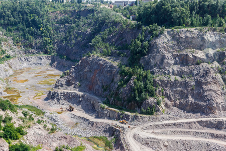 Extraction of mineral resources in the granite quarry Stock Photo