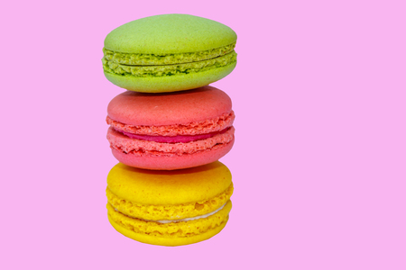 Tasty colorful macaroons on pink background