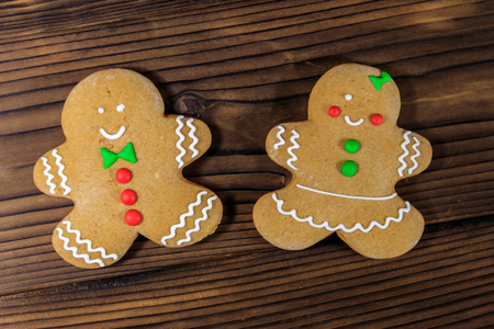Christmas gingerbread couple cookies on wooden table. Top view