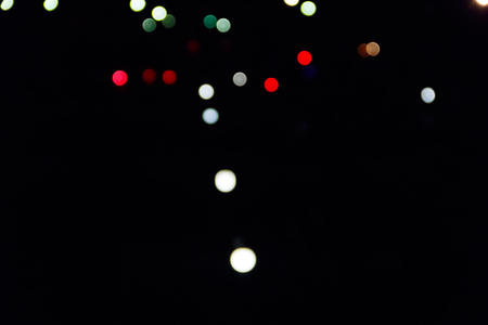 Abstract background of blurred city lights with bokeh effect Stock Photo