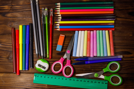 Set of school stationery supplies on wooden desk. Back to school concept
