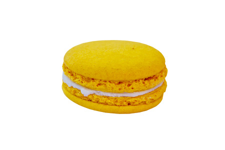 Tasty yellow macaroon isolated on white background