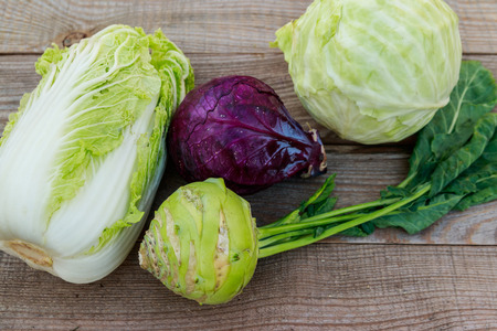 Several kinds of cabbage on rustic wooden table. Top view 스톡 콘텐츠